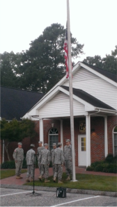 Cadets render appropriate honors after they post the national colors at half-mast in remembrance of the victims of 9/11
